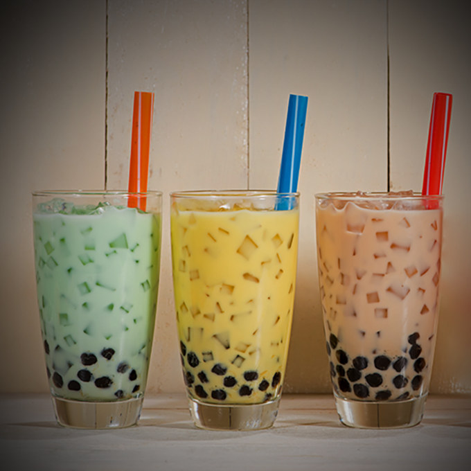Boba / Bubble tea. Homemade Various Milk Tea with Pearls on wood