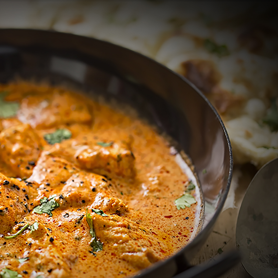 Butter chicken curry with tender chicken breast, cream, butter &