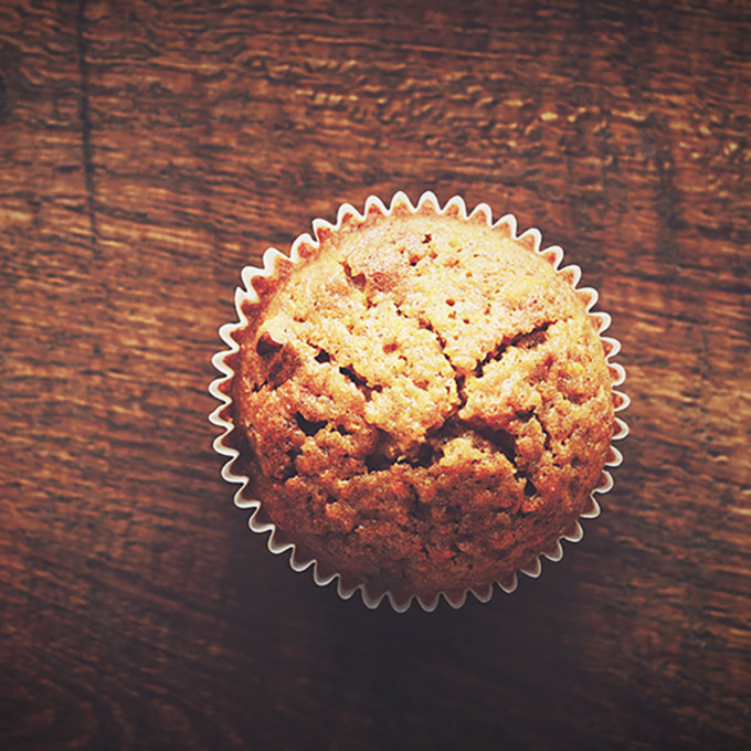 Homemade carrot muffin with empty space on brown wooden backgrou